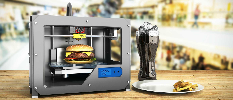 Impresora 3D imprimiendo una hamburguesa