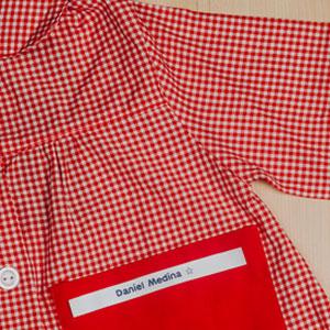 Babi infantil con etiqueta textil Brother