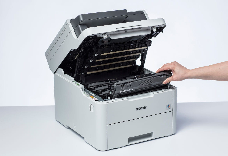 Impresora Brother abierta mostrando sus consumibles