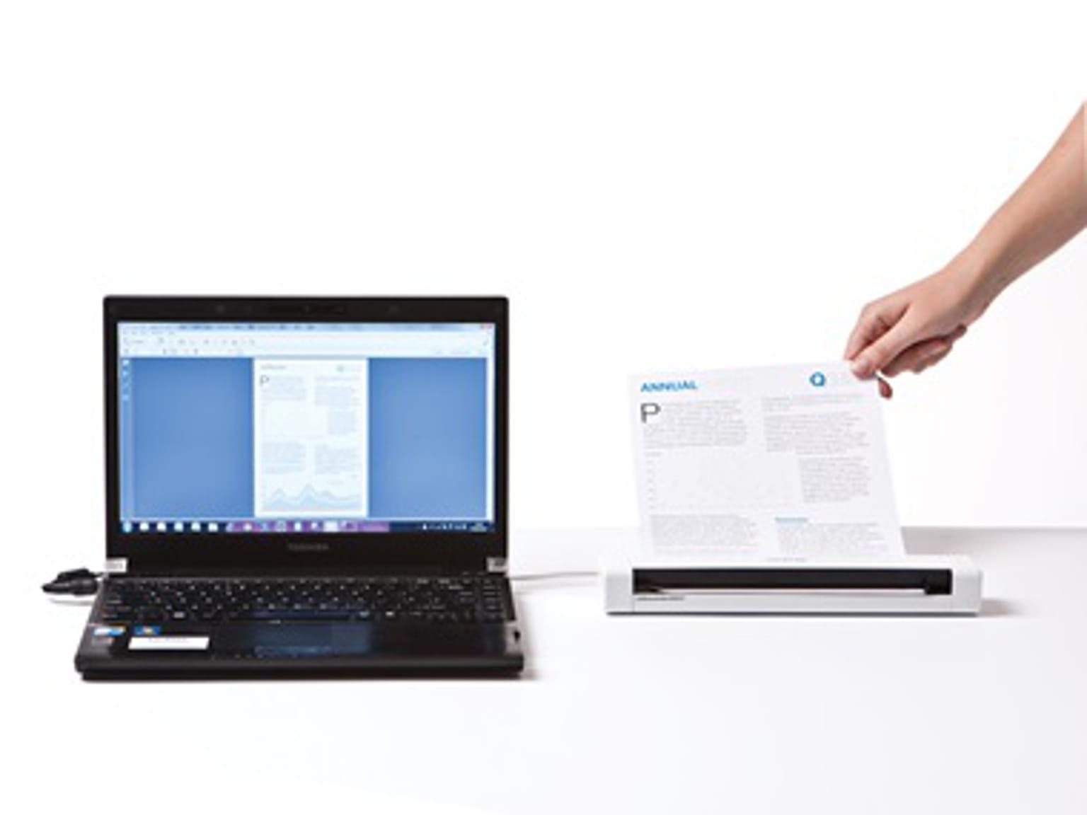 Escáner portátil Brother y ordenador portátil